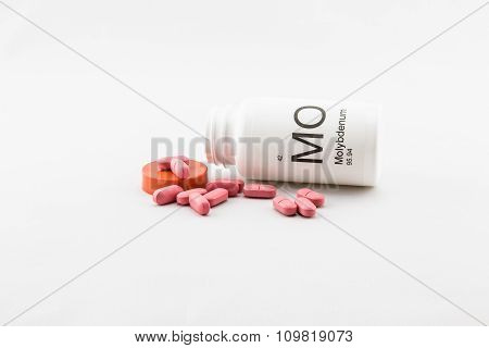 Tipped over bottle of molybdenum vitamins