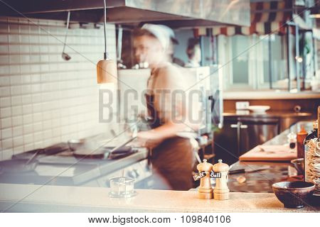 Blurred restaurant interior with salt and pepper on table
