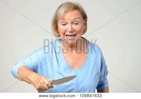 Elderly Woman Brandishing A Kitchen Knife
