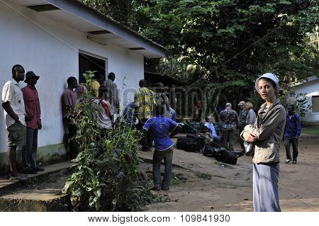 Central Africa Jungle, Congo, Africa - October 30, 2008: Beautiful Girl With Group Of Tourists In Bo