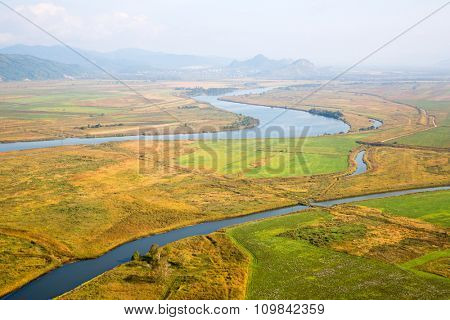 Beautiful autumn landscape in the valley of the river from a birds-eye. Primorsky Kray, Russia
