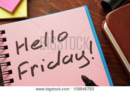 Notebook with the words  Hello Friday.
