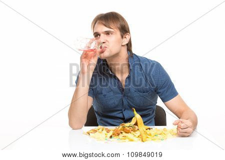 male slut drinking soda and eating chips. desk cesspool. isolated on white background