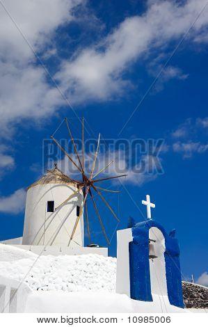 Church, windmill in Oia, Santorini island of Greece