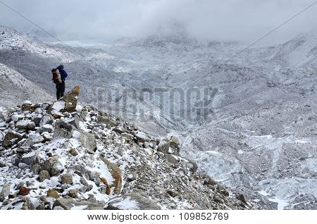 Mountaineer Standing On Hillside Waste Near Khumbu Icefall ,route to Everest's summit,Nepal,Asia