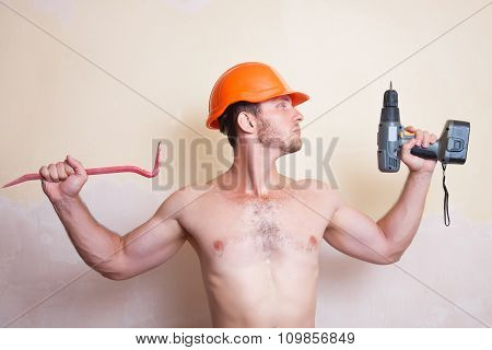 Man In Helmet With A Screwdriver And Crowbar