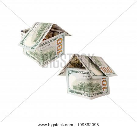 Two Houses of one hundred dollar bills on white.