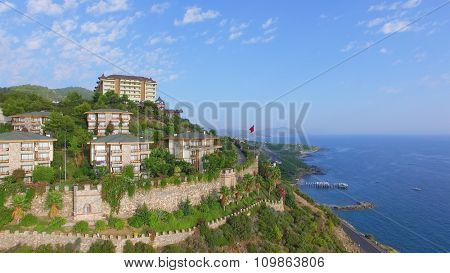 ALANIA - AUG 16, 2015: Hotel Utopia World on top of hill at summer day. Aerial view videoframe. Hotel Utopia World is a 5-star resort with total area of about 100000sq.m.