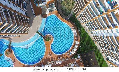 ALANIA - AUG 16, 2015: People get rest on pool side of Residential complex Azura Park at summer sunny day. Aerial view videoframe