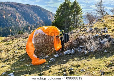 Paraglider accident. Parachute failed to start and got stuck in the bush. Saving the parachute after failure to start a paraglide. poster