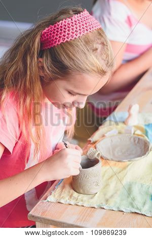 Girl Making Her First Pottery In Ceramic Workshop
