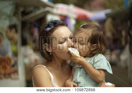 girl and mother eating ice cream