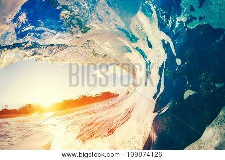 Blue Ocean Wave Crashing at Sunset
