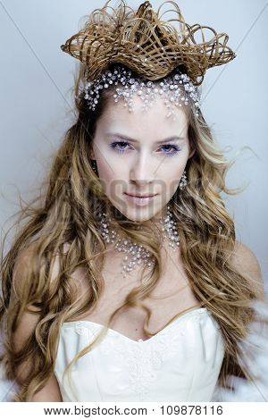 beauty young snow queen in fairy flashes with hair crown on her head close up winter