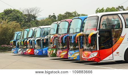 Colorful Buses Parking On The Station