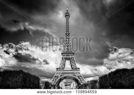 Eiffel Tower seen from Champ de Mars park in Paris, France. French Tour Eiffel in black and white