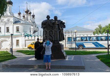 Pilgrims Are Photographed At Monument Of Saints Peter And Fevronia Of Murom