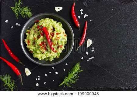 Guacamole Dip And Ingredients On Black Background