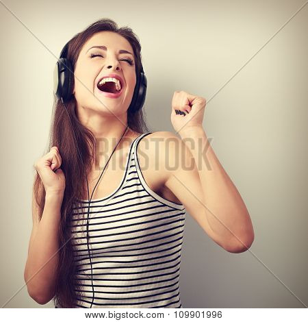 Dancing Happy Active Young Woman In Headphones Singing The Song. Vintage Portrait