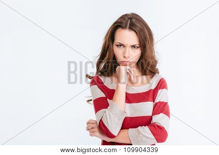 Portrait of a young angry woman looking at camera isolated on a white background
