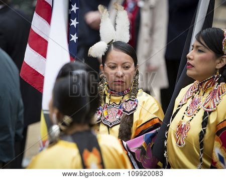 NEW YORK - NOVEMBER 11 2015: Native American women veterans from Sister Nations Color Guard assemble in Native regalia in Madison Square Park before the parade up 5th Ave on Veterans Day in Manhattan.