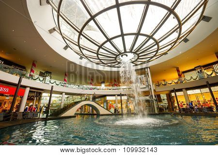 SINGAPORE - NOVEMBER 08, 2015: view on Rain Oculus. Rain Oculus is a large whirlpool forms inside a 70 foot diameter acrylic bowl and falls 2 stories to a pool below