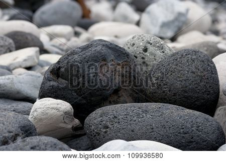 Black Volcanic Rocks On Beach Of Hellnar In Iceland
