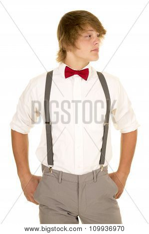 Young Man In Suspenders Stand Look To Side
