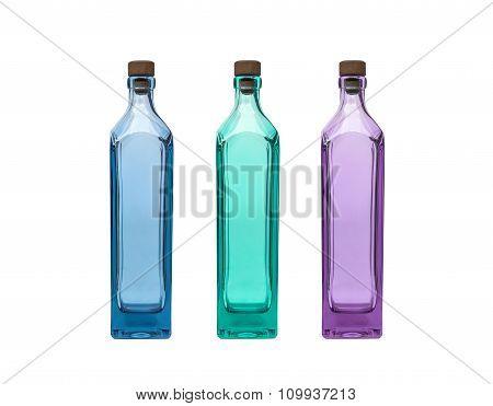 Empty blue aqua and purple glass bottle