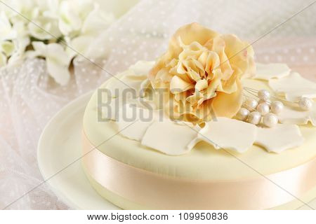 Cake with sugar paste flowers, on light background poster