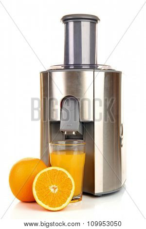 Stainless juice extractor with glass of orange juice isolated on white background