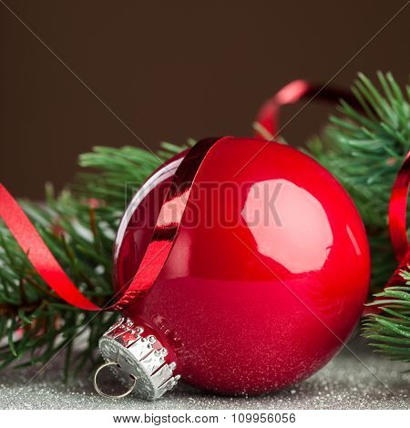 Christmas ball with green fir-tree