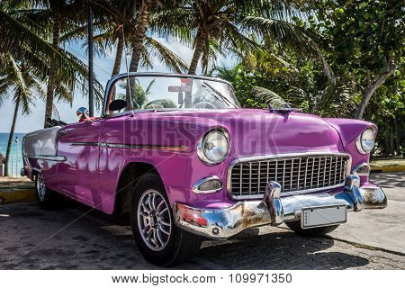 Pink Classic Car Parked Near The Beach In Cuba
