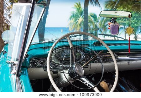Interior with cockpit view int he classic car in Cuba