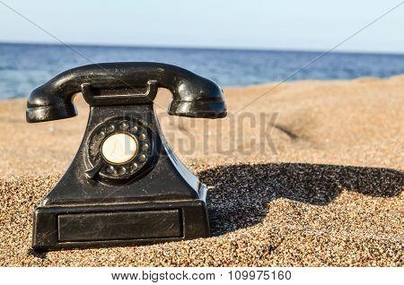 Phone on the Sand Beach