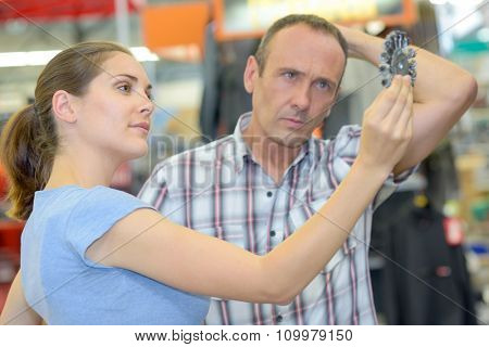 couple looking at drill bit