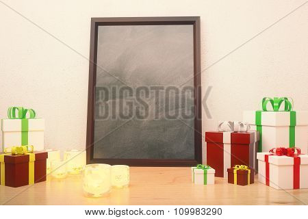 Blank Picture Frame With Gift Boxes On  The Floor, Mock Up