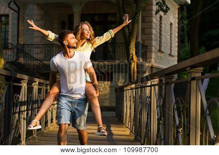 Guy and girl walking along the beautiful ranch.