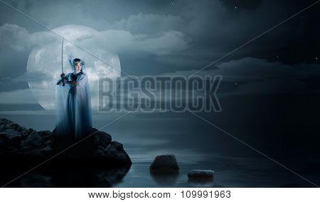 Elven girl on sea coast at night