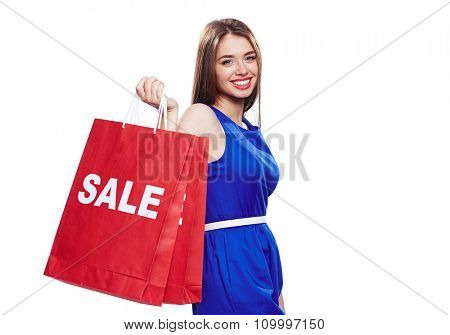 Happy sale lover with two paperbags looking at camera