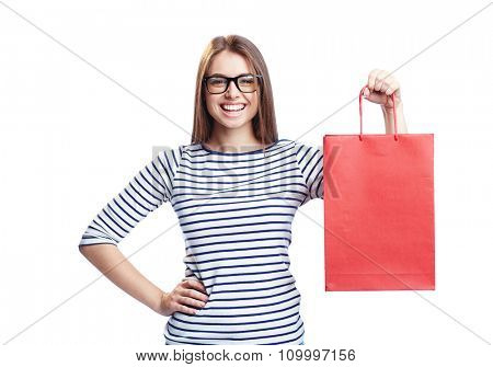 Young shopaholic with red paperbag