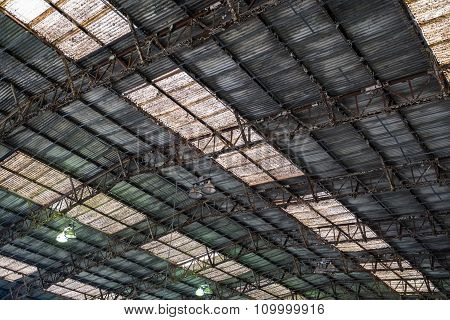 Background Of A Rusty Roof With Skylights.