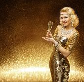 Woman Gold VIP Lady with Champagne Glass Fashion Model posing in Rich Retro Golden Dress poster