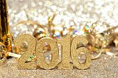 New Years Eve 2016 golden numbers and decorations with twinkling gold background poster