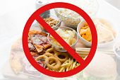 fast food, low carb diet, fattening and unhealthy eating concept -close up of fast food snacks and cola drink behind no symbol or circle-backslash prohibition sign poster