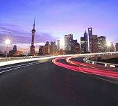 Empty road surface with Shanghai Bund Lujiazui modern city buildings backgrounds Dawn poster