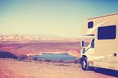 Vintage toned RV (camper) parked by canyon family vacation concept Lake Powell USA. poster