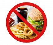 fast food, low carb diet, fattening and unhealthy eating concept - close up of hamburger or cheeseburger, deep-fried squid rings and french fries behind no symbol or circle-backslash prohibition sign poster