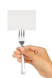 hand holding fork with card