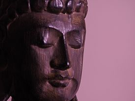 Buddha face in carved wood